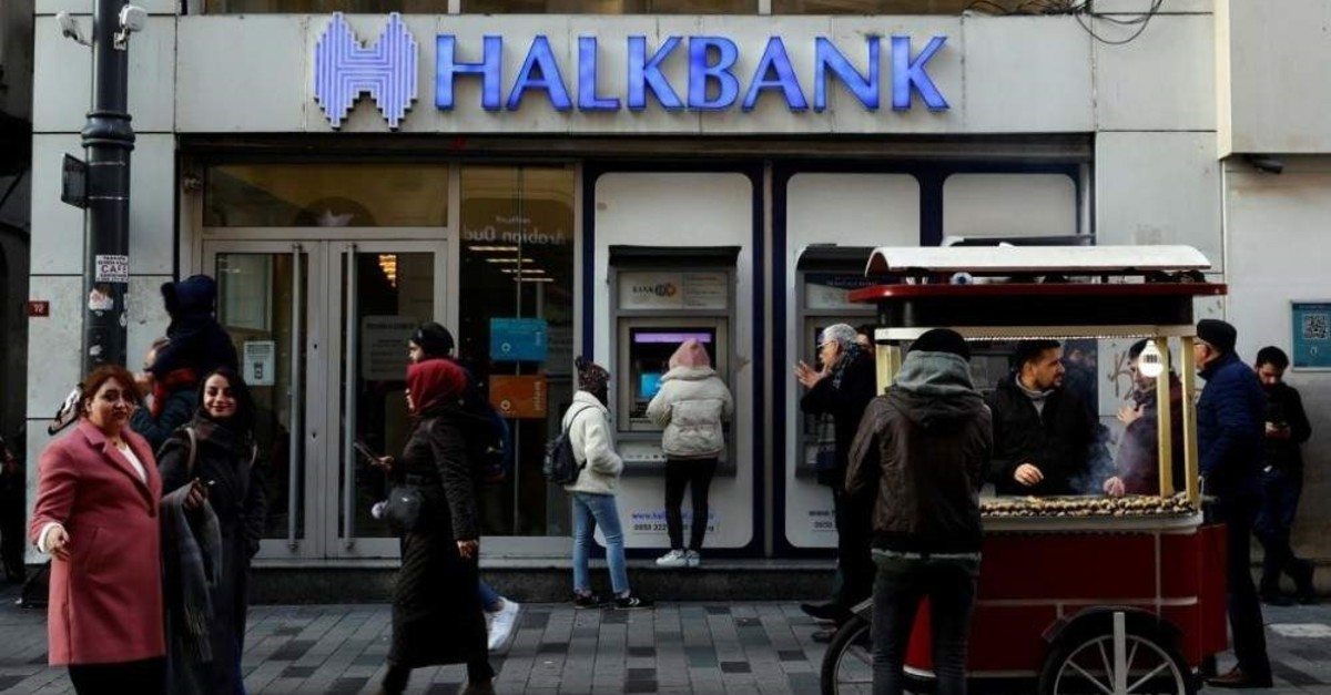 People walk past a branch of Halkbank in central Istanbul, Turkey, Jan. 22, 2020. (Reuters Photo)