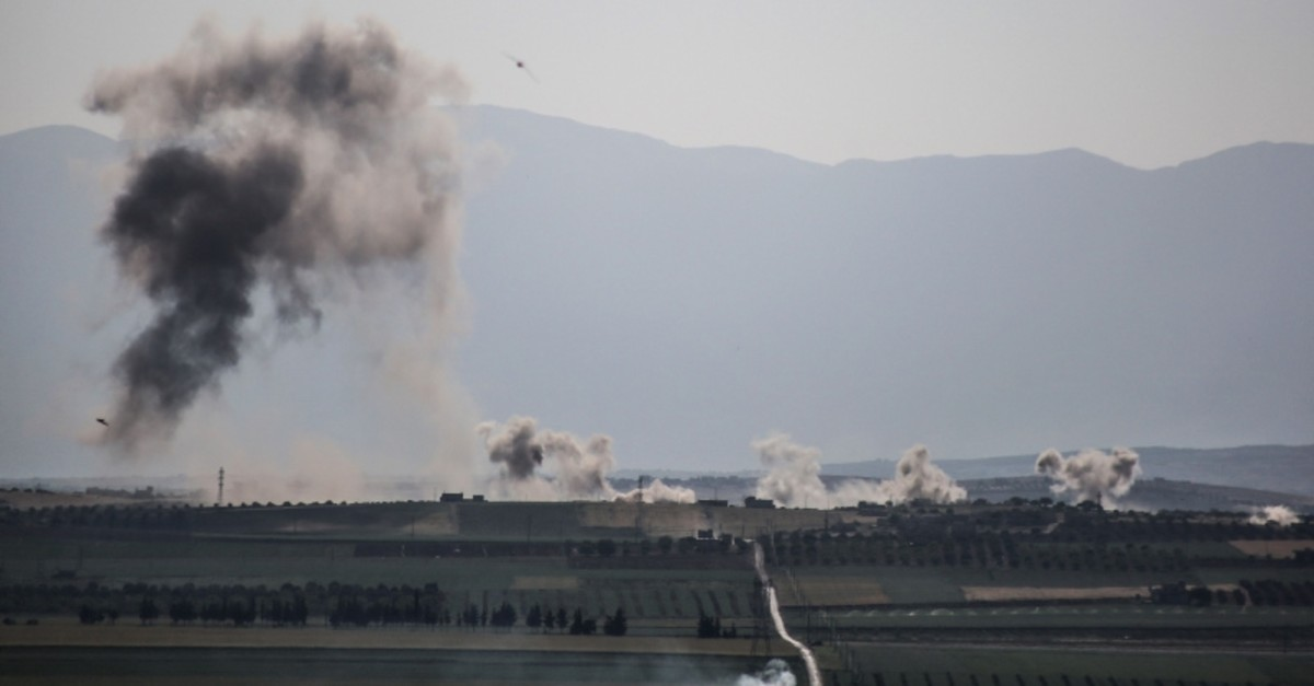 Smoke billows following reported shelling around the village of al-Muntar on the southern edges of the opposition-held Idlib province on May 12, 2019. (AFP Photo)