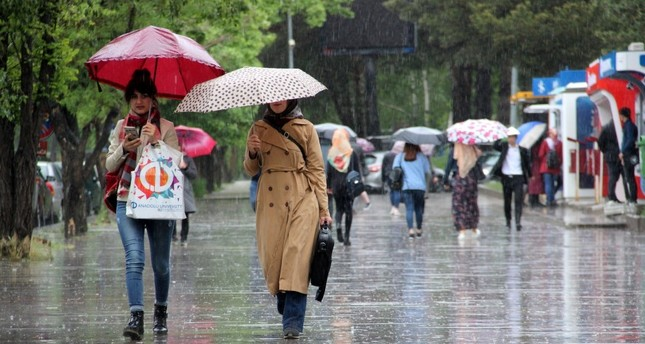 People walk in the rain in the northeastern city of Erzincan in this undated photo.