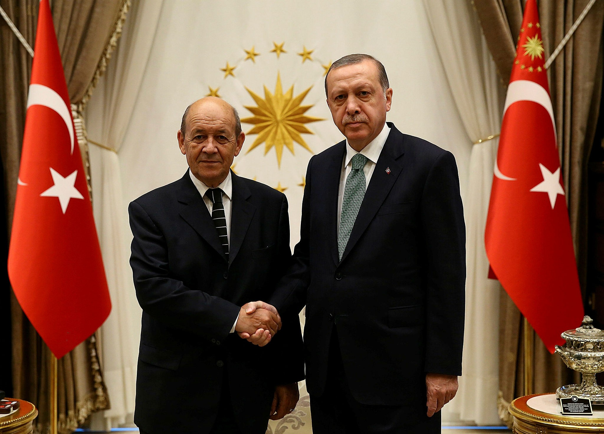 Le Drian (L) and Erdou011fan shake hands in Beu015ftepe Presidential Complex (Reuters Photo)