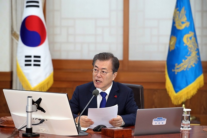 South Korean President Moon Jae-in speaks during a cabinet meeting at the presidential Blue House in Seoul, South Korea, Tuesday, Jan. 2, 2018. (AP Photo)