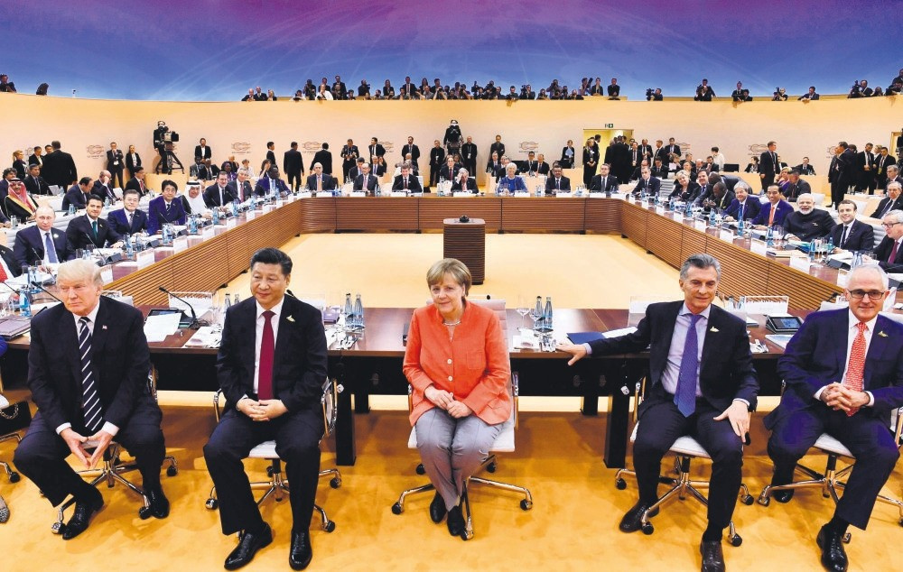 (From L - R) U.S. President Trump, Chinese President Xi, German Chancellor Merkel, Argentiniau2019s President Macri and Australian PM Turnbull sit for photographers at the start of the first working session of G20 meeting, Hamburg, Germany, July 7, 2017.