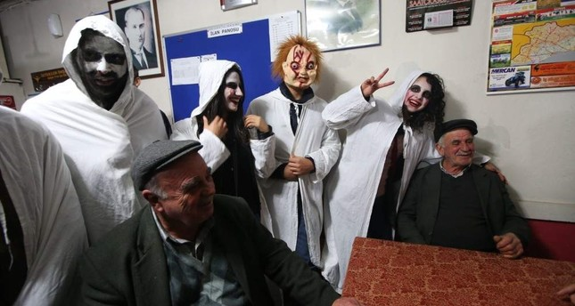 Expect an evening of masses dressed up in white sheets with scary face paint and spooking neighbors pounding on windows. Photo: Salih Baran