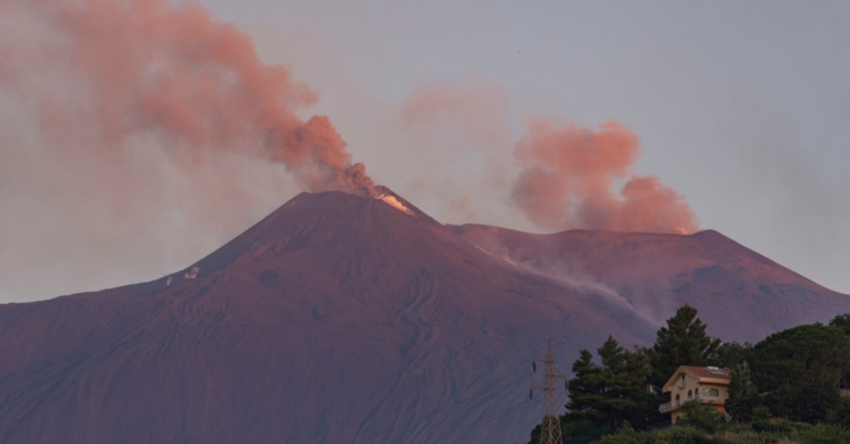 Smoke billows from Mount Etna volcano, the largest of Italy's three active volcanoes, near the Sicilian town of Catania, southern Italy, Saturday, July 20, 2019. (AP Photo)