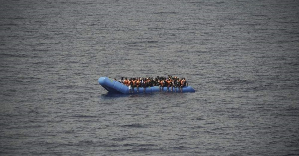 In this Sept. 17, 2019, file photo, migrants aboard a blue plastic boat are seen in the Mediterranean Sea. (AP Photo)