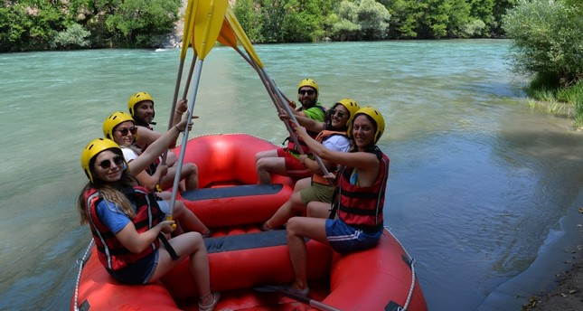 Outdoor sports lovers flock to Tunceli's famous Munzur River for rafting.