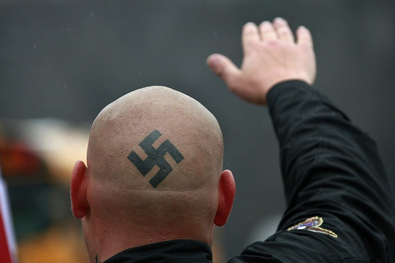 Neo-Nazi protestors organized by the National Socialist Movement demonstrate near where the grand opening ceremonies were held for the Illinois Holocaust Museum & Education Center April 19, 2009 in Skokie, Illinois. (Scott Olson/Getty Images/AFP)