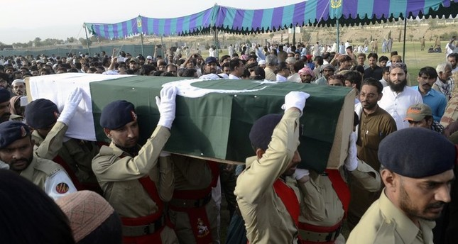 Pakistani troops carry the casket, wrapped in national flag, of provincial candidate Siraj Raisani, who was killed in the Friday's suicide bombing in Mastung, during a funeral prayer in Quetta, Pakistan, Saturday, July 14, 2018. (AP Photo)