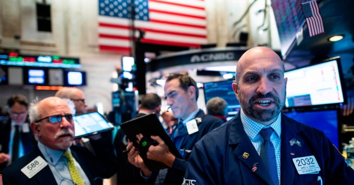 Traders work before the opening bell at the New York Stock Exchange (NYSE) on November 14, 2019 in New York City. (AFP Photo)