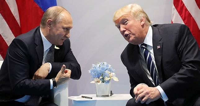 Russian President Vladimir Putin (L) and US President Donald J. Trump (R) meet on the sidelines of the G20 summit in Hamburg, Germany, 07 July 2017. (EPA Photo)