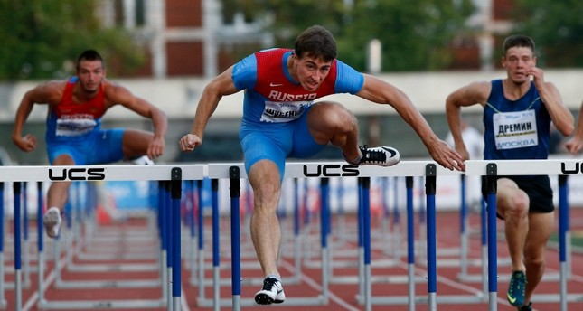 In this Thursday, July 28, 2016, file photo, world hurdles champion Sergei Shubenkov, center, competes during the Russian Stars 2016 track and field competitions in Moscow, Russia. (AP Photo)