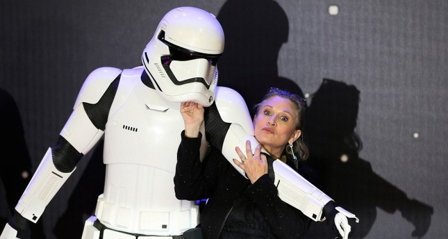Carrie Fisher poses for cameras as she arrives at the European Premiere of Star Wars, The Force Awakens in Leicester Square, London, on December 16, 2015. (Reuters Photo)