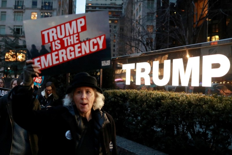 People gather to protest against U.S. President Donald Trump's declaration of a national emergency to build a border wall, at Trump International Hotel & Tower in Manhattan, New York, U.S. February 15, 2019. (Reuters Photo)