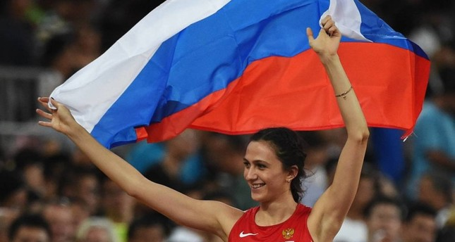 Reigning world high jump champion Maria Lasitskene says she wants to block out the whole doping controversy.