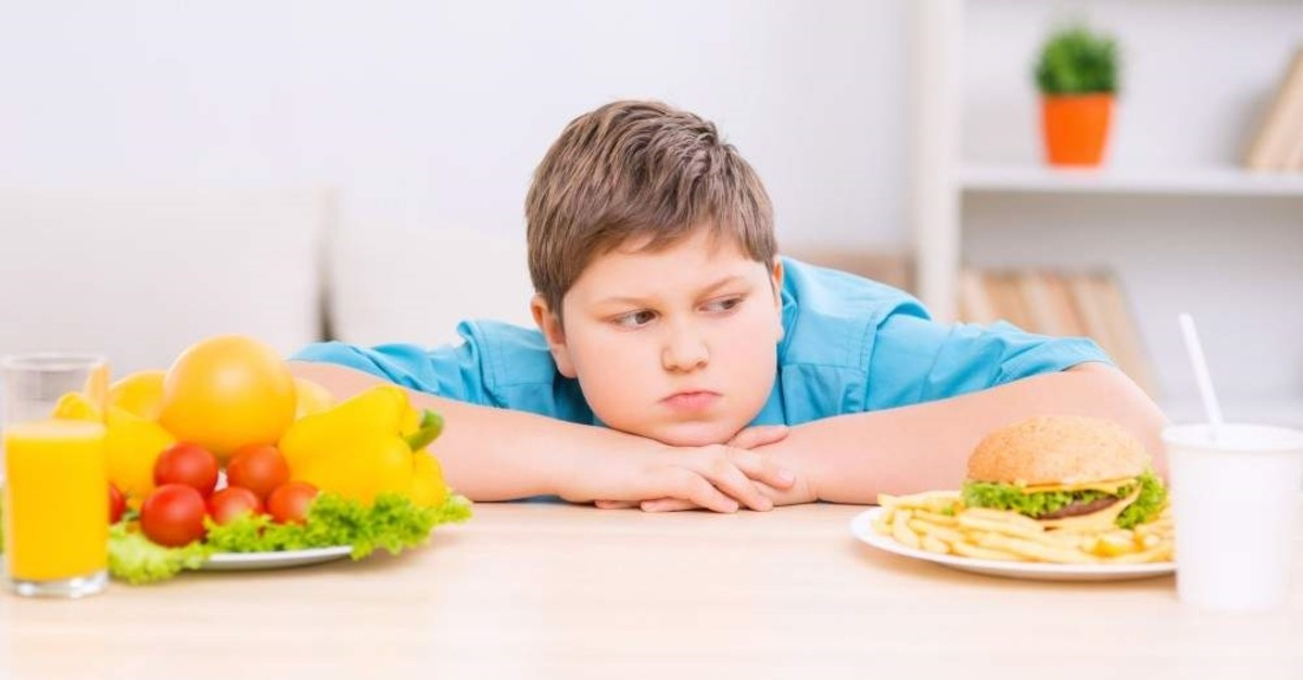 There are various causes of child obesity, including lack of exercise and poor choice of diet. (iStock)