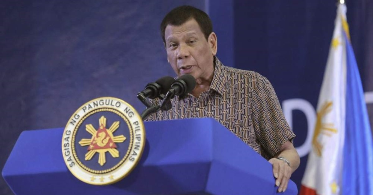 In this Jan. 23, 2020, photo provided by the Malacanang Presidential Photographers Division, Philippine President Rodrigo Duterte delivers his speech at the San Isidro Central School during the distribution of benefits to former rebels in Leyte province, southern Philippines. (Malacanang Presidential Photographers Division via AP)