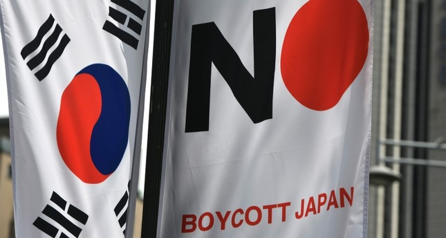 A South Korean flag L and a banner R that reads Boycott Japan hangs along a street in Seoul's Jung-gu district on August 6, 2019. AFP Photo