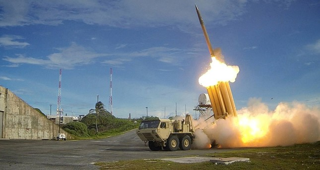 A Terminal High Altitude Area Defense (THAAD) interceptor is launched during a successful intercept test, in this undated handout photo provided by the U.S. Department of Defense, Missile Defense Agency. (via Reuters)