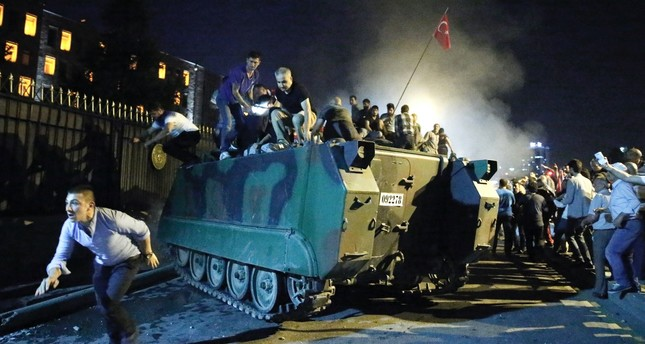 Anti-coup protesters stop a tank outside the military headquarters in Ankara on July 15, 2016. Some defendants sentenced to life in yesterday's trial were sent there by coup plotters in a bid to take it over.