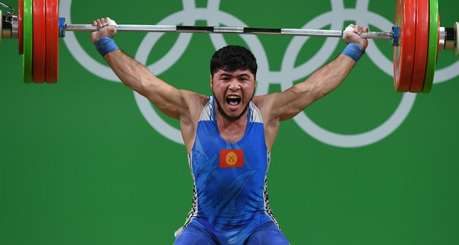 Picture taken on August 9,2016 shows Kirghyzstan's Izzat Artykov competing during the Men's 69kg weightlifting competition at the Rio 2016 Olympic Games in Rio de Janeiro on August 9, 2016. (AFP Photo)