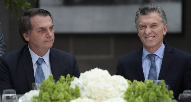 Brazil's President Jair Bolsonaro, left, and Argentina's President Mauricio Macri are pictured during a lunch at the government house in Buenos Aires, Argentina, Thursday, June 6, 2019.(AFP Photo)