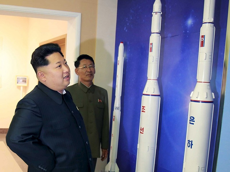 North Korean leader Kim Jong-Un looks at newly built rockets in this undated photo released by KCNA. (Reuters Photo)