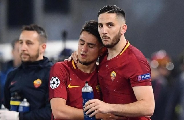 Roma's Kostas Manolas (R) celebrates with teammate Cengiz Ünder after scoring the key third goal during the UEFA Champions League quarter final second leg match at the Olimpico Stadium in Rome.