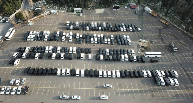 Van used by Uber drivers sit in an Istanbul lot (DHA Photo)