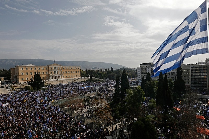 A giant Greek flag hangs from a crane waves over protesters during a rally over name dispute with Macedonia in Athens, Greece, Feb. 4, 2018. (EPA Photo)