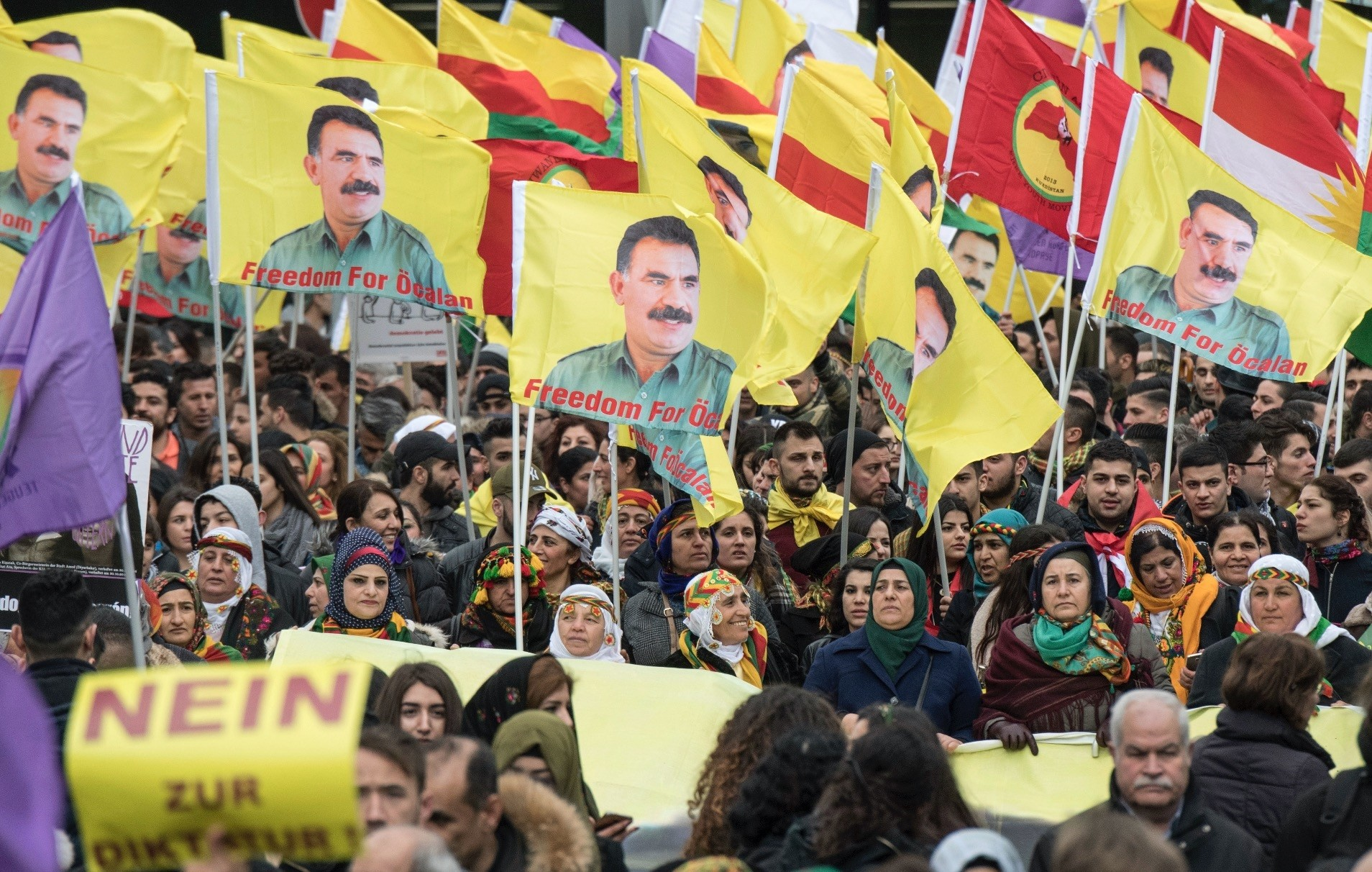 PKK terrorist group supporters seen in Frankfurt, Germany waving flags with portraits of the imprisoned PKK leader Abdullah u00d6calan, who is responsible for killing hundreds of Kurdish and Turkish civilians and security forces, March 18.
