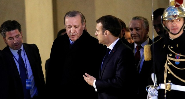 President Erdoğan L leaves after a meeting with French President Macron R at the Elysee Palace, Paris, Jan. 5. AP Photo