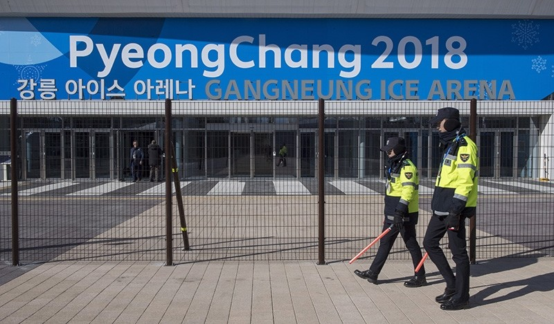 Police officers walk the perimeter of the Gangneung Ice Arena where the figure skating and short track speed skating will be held during the Pyeungchang Winter Olympics Monday, Feb. 5, 2018 in Gangneung, South Korea. (AP Photo)