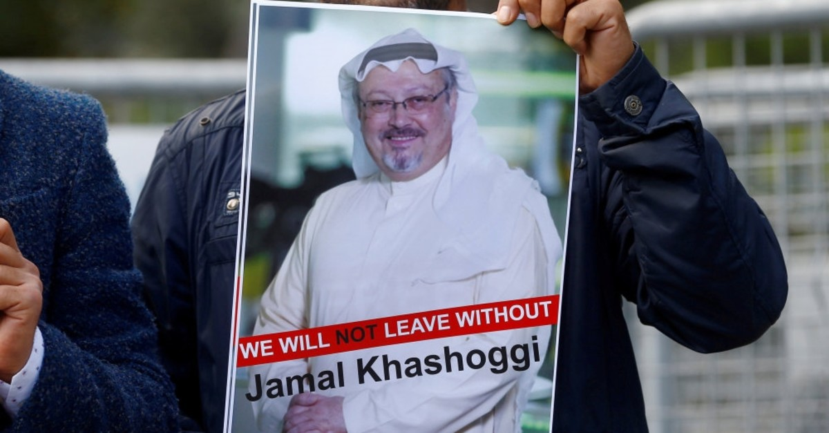A demonstrator holds a picture of Saudi journalist Jamal Khashoggi during a protest in front of Saudi Arabia's Consulate in Istanbul, Oct. 5, 2018.