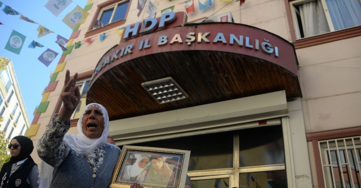 A mother protests the abduction of her son by the PKK in front of the provincial office of the Peoples' Democratic Party (HDP) in southeastern Diyarbaku0131r province, Sept. 5, 2019.