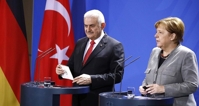 German Chancellor Angela Merkel and Turkish Prime Minister Binali Yıldırım attend a news conference at the Chancellery in Berlin, Germany Feb.15, 2018. (Reuters Photo)