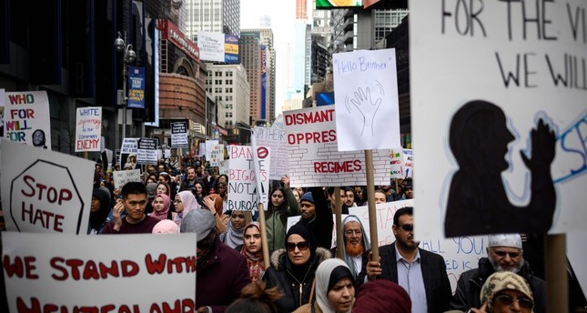 Demonstrators take part in a protest against growing Islamophobia, white supremacy and anti-immigrant bigotry following the attacks in Christchurch, in Time Square, New York City, March 24, 2019.
