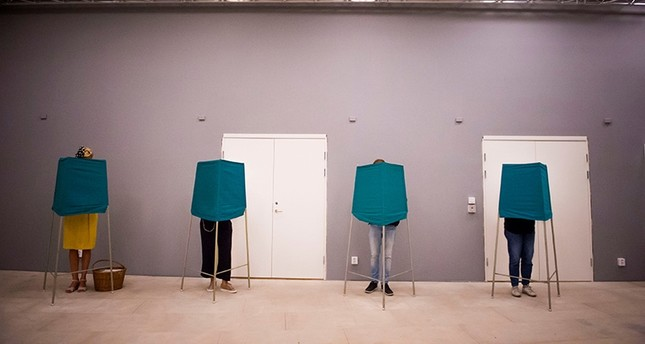 People vote in polling booths during election day in Stochholm, Sweden Sept. 9, 2018. (Reuters Photo)