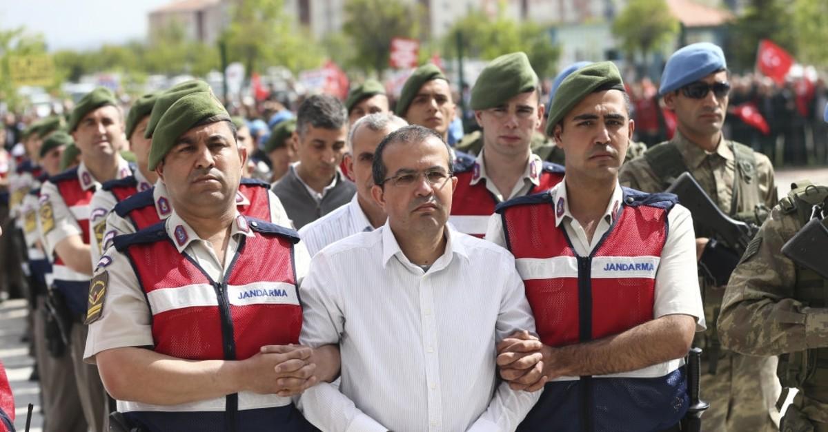 Mehmet Partigu00f6u00e7 is accompanied to a courtroom in Ankara, May 22, 2017. Partigu00f6u00e7, a member of the putschists' ,Council, faces life imprisonment.
