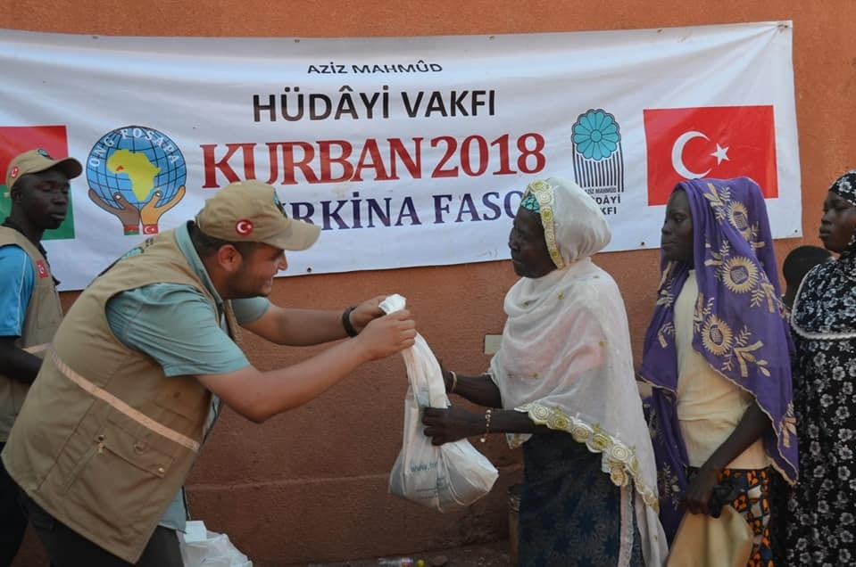A charity worker delivers aid in Burkina Faso.