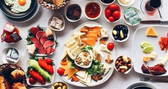 A typical Turkish breakfast includes bread, butter, jam and honey, olives, tomatoes, cucumbers, cheese, yogurt, cold meats, fruit juice, eggs, and tea or coffee. (FILE Photo)