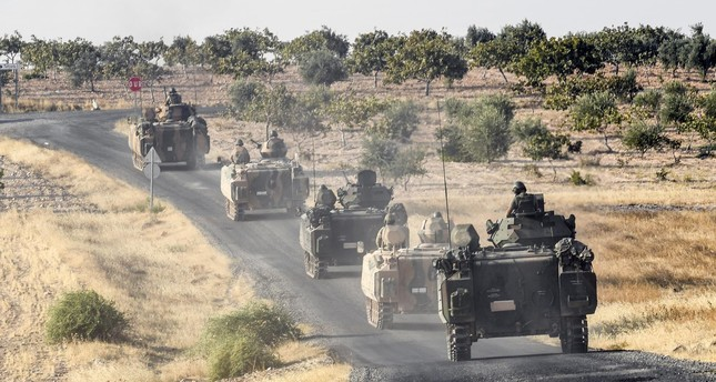 Turkish troops move toward the border with Syria as part of preparation in Operation Euphrates Shield last year.