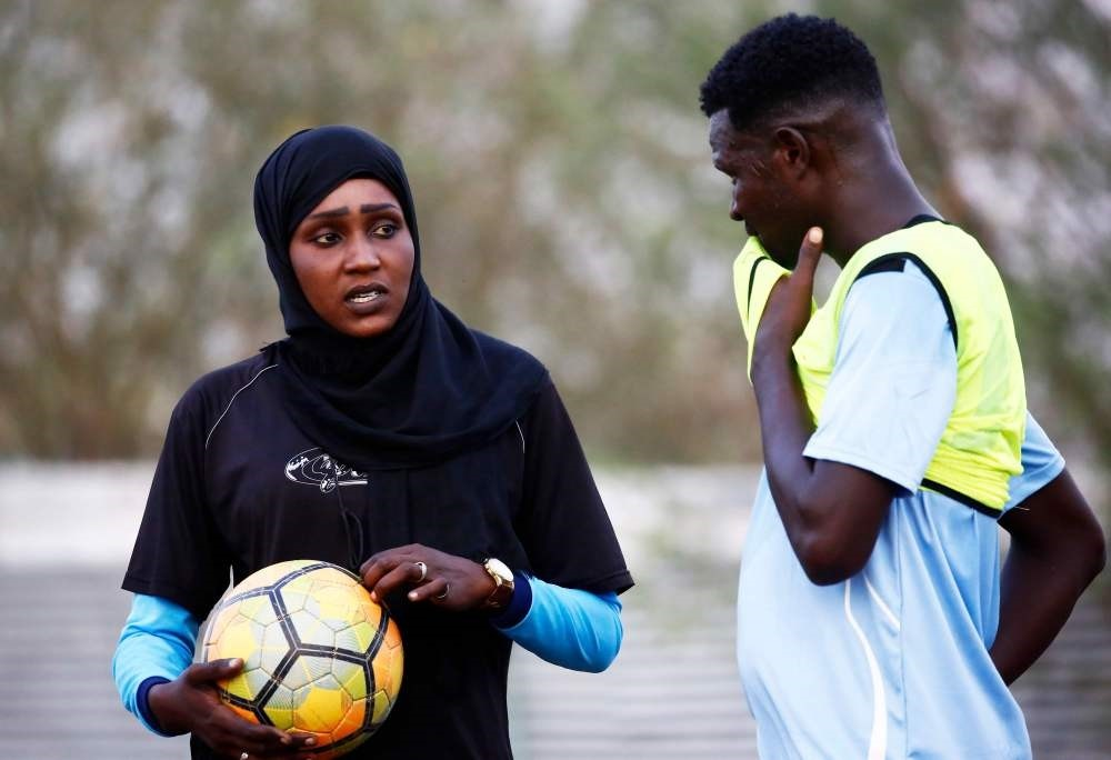 Salma al-Majidi, acknowledged by FIFA as the first Arab and Sudanese woman to coach a men's football team in the Arab world, instructs the Al-Ahly Al-Gadaref club during a training session in the town of Gedaref, east of Khartoum.