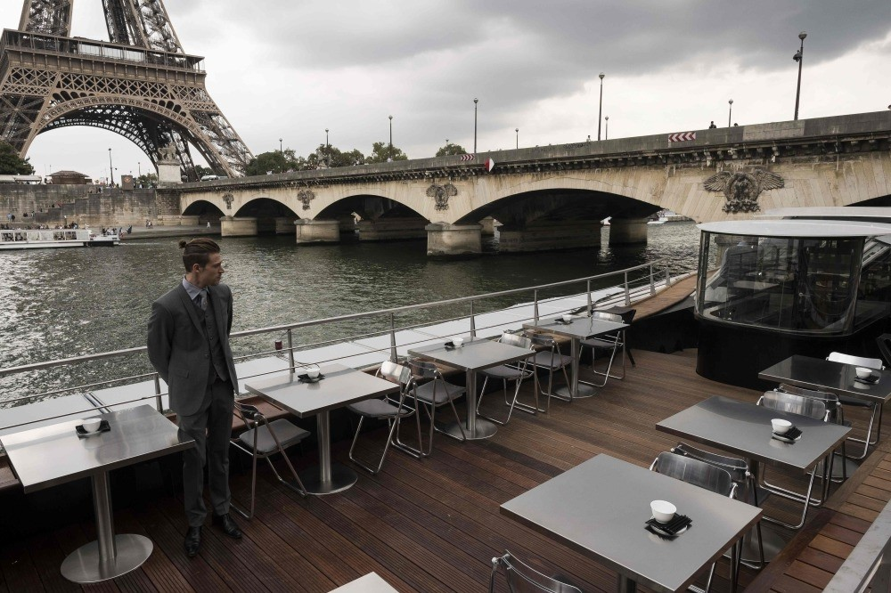 A waiter stands at French chef Alain Ducasse's new boat restaurant, the ,Ducasse sur Seine.,