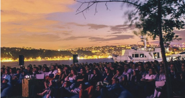 Photo shows an open-air screening on the shore, courtesy of Kundura Cinema.