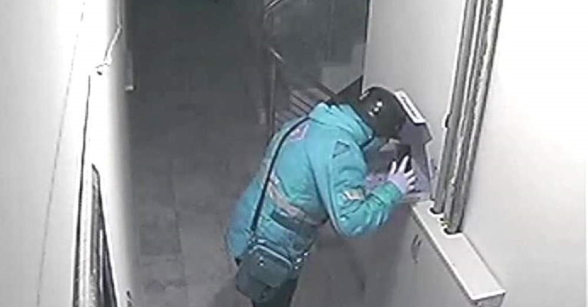 A security camera footage shows Burak S. spitting on pizza. (DHA Photo)