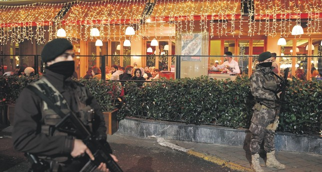 Special Operations police stand outside a restaurant at Istanbul's Taksim Square during New Year's Eve. Security measures were stepped up across the city after a Daesh militant killed 39 people at a nightclub in the early hours of Jan. 1, 2017.