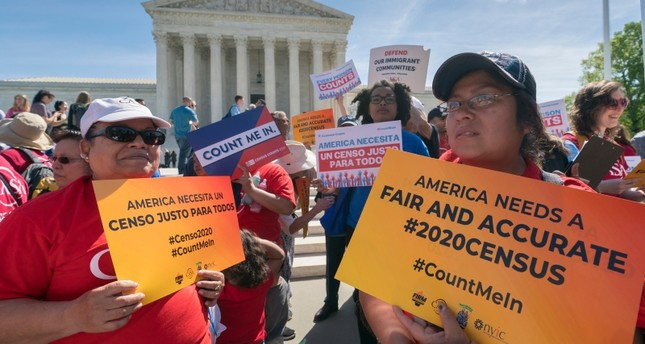In this April 23, 2019 file photo, immigration activists rally outside the Supreme Court as the justices hear arguments over the Trump administration's plan to ask about citizenship on the 2020 census, in Washington. (AP Photo)
