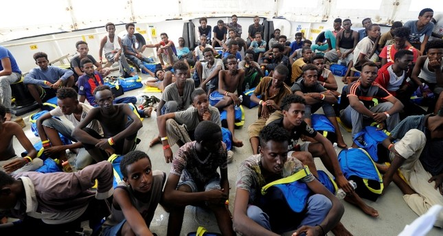 Migrants rest after being rescued by SOS Mediterranee organisation and Doctors Without Borders during a search and rescue (SAR) operation with the MV Aquarius rescue ship in the Mediterranean Sea, August 10, 2018. (REUTERS Photo)