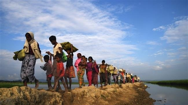 Rohingya Muslim refugees, who were stranded after leaving Myanmar, walk toward the Balukhali refugee camp after crossing the border with Bangladesh, Nov. 2, 2017.