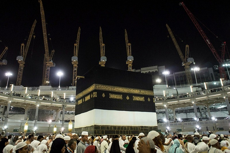 Towering construction cranes used in the ongoing expansion the Grand Mosque overlook the Kaaba, the cubic building at the mosque in the Muslim holy city of Mecca, Saudi Arabia, Sunday, Sept. 13, 2015. (AP Photo)